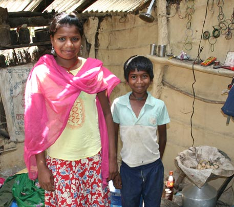 Devaki and her brother in their one room house